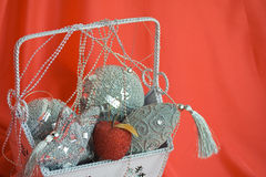 Closeup image of bag with christmas toys on red Stock Photos