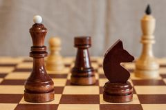 Closeup image of a board game chess on a gray background white and black figures.  Royalty Free Stock Photo