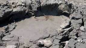 Bubbling mud in a mud volcano.
