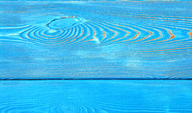 Closeup image of bumpy wooden wall background painted blue Royalty Free Stock Image