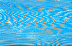 Closeup image of bumpy wooden wall background painted blue Stock Photos