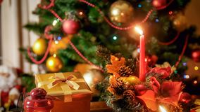 Closeup image of burning candle in traditional Christmas wreath. Closeup photo of burning candle in traditional Christmas wreath stock photos