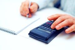 Closeup of a businessman calculating Royalty Free Stock Photos