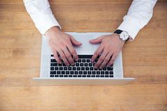 Closeup image of a businessman hands using laptop Stock Photography