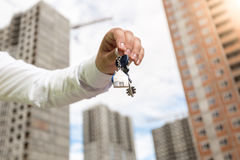Closeup image of businessman holding keys from new real estate Stock Image