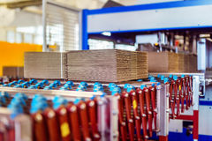 Closeup image of cardboard boxes on conveyor belt Royalty Free Stock Photo