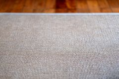 Closeup image of carpet texture on the floor. Closeup image of carpet texture on wooden floor stock photography