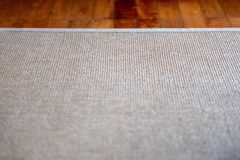 Closeup image of carpet texture on the floor. Closeup image of carpet texture on wooden floor stock images