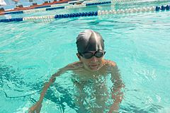 Closeup image of a children in swimming and Royalty Free Stock Photos
