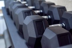 Closeup image of chrome dumbbells. In modern gym Royalty Free Stock Photo