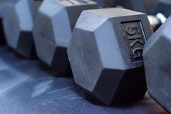 Closeup image of chrome dumbbells. In modern gym Stock Photos