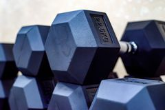 Closeup image of chrome dumbbells. In modern gym Royalty Free Stock Images