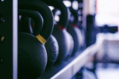 Closeup image of chrome dumbbells. In modern gym Stock Photography