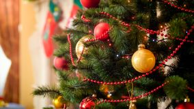 Closeup image of colorful lights glowing on adorned Christmas tree at house. Closeup photo of colorful lights glowing on adorned Christmas tree at house stock images