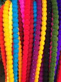 Colorful Decorative Yarn Strand Malas. A closeup image of colorful strands of yarn tied into balls to look like necklaces of beads. These are used in craft as a Royalty Free Stock Photos