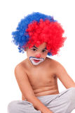 Closeup image of the cute little clown boy. Little clown boy on the white background Royalty Free Stock Image