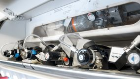 Closeup image of emergency oxygen cylinders, valves and pipes on modern jet aircraft. Closeup photo of emergency oxygen cylinders, valves and pipes on modern jet royalty free stock photos