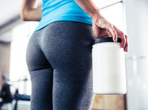 Closeup image of female body at gym Royalty Free Stock Photography