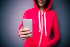 Closeup image of a girl holding smartphone Royalty Free Stock Photo