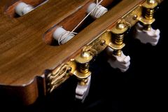 Closeup image of gold plated classical guitar tune Royalty Free Stock Image
