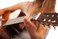 Closeup image of guitar in woman hands Royalty Free Stock Image