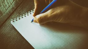 Closeup image of hand writing down on a blank. Top view of female hands making some notes work, studying, shopping, blogging conce. Pt stock images