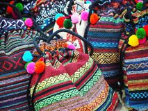 Colorful Handmade Tribal Fabric Bags. Closeup image of handmade tribal fabric bags at the souvenir shop stock photography