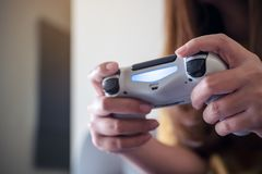 Hands holding the game controller while playing games. Closeup image of hands holding the game controller while playing games Stock Images