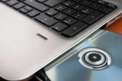 Closeup image of a laptop and CD Royalty Free Stock Photo