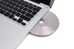 Closeup image from a laptop and a CDRom Royalty Free Stock Photography