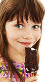 Closeup image of a little girl with ice cream. Isolated on white background stock photo