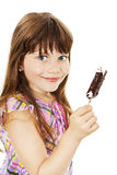 Closeup image of a little girl with ice cream. Isolated on white background royalty free stock photography