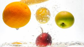 Closeup image of lots of tasty fresh juicy fruits falling in water and splashing. Closeup photo of lots of tasty fresh juicy fruits falling in water and stock photography