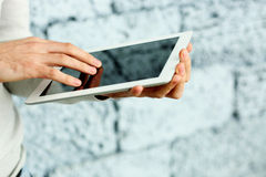Closeup image of male hand touching display of tablet computer Royalty Free Stock Photos