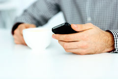 Closeup image of a male hand typing on smartphone Royalty Free Stock Photography