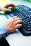 Closeup image of male hands typing Royalty Free Stock Images