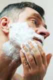 Image of mature man shaving Royalty Free Stock Photography