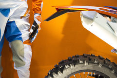 Closeup image of a motocross biker protective clothing and motocross bike Stock Photography