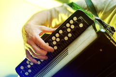 Closeup image of musician playing on accordion Stock Image
