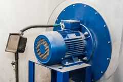 Close up old blue electric motor. Closeup image of obsolete powerful electric motor for modern industrial equipment stock photo
