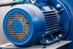 Close up old blue electric motor. Closeup image of obsolete powerful electric motor for modern industrial equipment royalty free stock images