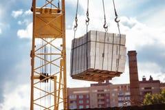 Free Closeup Image Of Crane Lifting Heap Of Bricks At Blue Sky Royalty Free Stock Images - 70640899