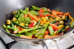 Closeup Image Of Roasting Mexican Vegetables Mix In Wok Pan Side View Royalty Free Stock Image