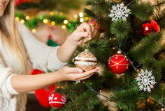 Free Closeup Image Of Woman Holding Golden Christmas Bauble In Hands Royalty Free Stock Photo - 76916925