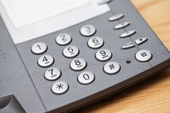 Closeup image of office phone Royalty Free Stock Images