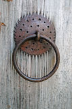 Closeup image of old door with circle iron door-handle Stock Photo