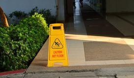 Caution sign on walkway stock images