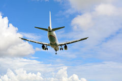 Passenger airplane landing to runway Royalty Free Stock Photography