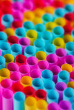 Closeup image of pastel colored straws on black background Stock Images