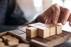 People playing wooden Tic Tac Toe game or OX game. Closeup image of people playing wooden Tic Tac Toe game or OX game Stock Photos